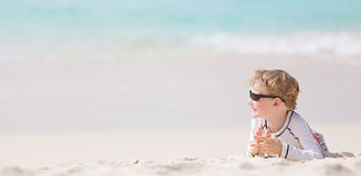 Kid at the beach Stock Images