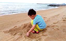 Kid On Beach Playing Sand Royalty Free Stock Image
