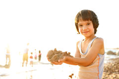 Kid on beach in sand playing, royalty free stock photos