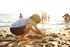 Kid on beach in sand playing, Royalty Free Stock Images
