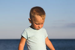 Kid on a beach in sunset light Royalty Free Stock Photography
