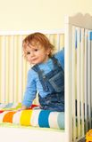 Kid in the bed Stock Photography