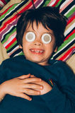 Kid in bed with eye patches Royalty Free Stock Photography