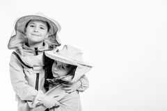 Kid in beekeeper`s suits posing in studio white background. royalty free stock photo