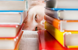 Kid behind the Books Stock Image