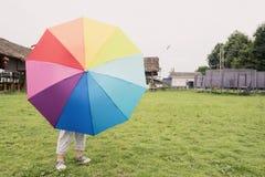 Kid behind umbrella Royalty Free Stock Photo