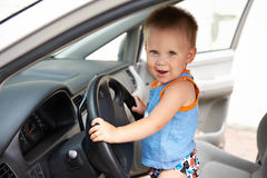 Kid behind the wheel of a big car Royalty Free Stock Photo