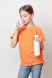 Kid and beverages Royalty Free Stock Photos