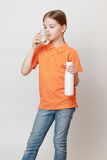 Kid and beverages Royalty Free Stock Image