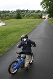 Kid on bicycle Stock Image