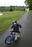 Kid on bicycle Stock Image