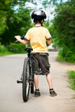 Kid with bicycle Royalty Free Stock Photos