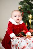Kid with big Christmas gift box Stock Photos
