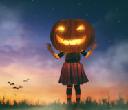 Kid with a big pumpkin head royalty free stock images