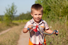 Kid with the bike Stock Photos
