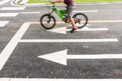 Kid bike learning  in park bangkok Stock Image