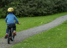 Kid on the bike Royalty Free Stock Photography