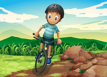 A kid biking at the hilltop Stock Photography
