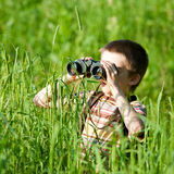 Kid with binocular royalty free stock photos