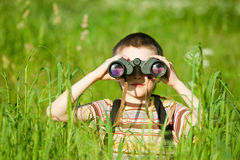 Kid with binocular Stock Images
