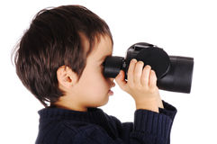 Kid with binoculars Royalty Free Stock Images