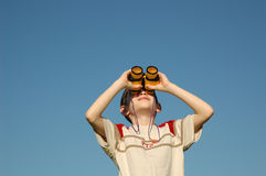 Kid with binoculars Stock Images