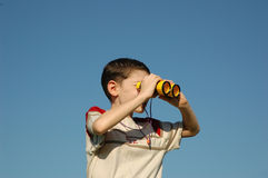 Kid with binoculars Stock Photos