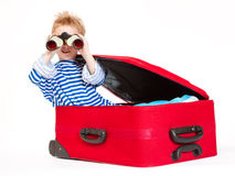 Kid with binoculars sail in suitcase Royalty Free Stock Photos
