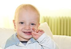 Kid biting his finger Royalty Free Stock Images