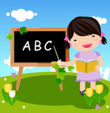 Kid and blackboard Stock Images