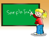 Kid at blackboard Royalty Free Stock Image
