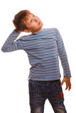 Kid blond in striped sweater thinks boy scratching Stock Photos