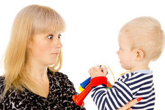 Kid blowing on mother in football beep Stock Photography