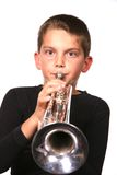 Kid Blowing Trumpet Royalty Free Stock Photos