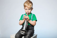 Kid Blowing Trumpet. Isolated Young Boy Blowing Trumpet Stock Images