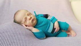 Kid in blue costume, sleeping on side stock footage