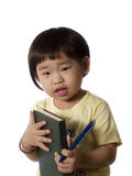 Kid with book and pen. Little Chinese girl holding note book and pen stock photography