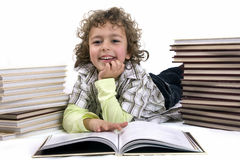 Kid with books Stock Images