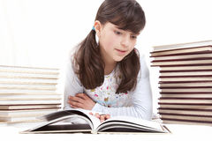Kid with books Royalty Free Stock Images