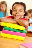Kid with books Stock Photo