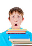 Kid with the Books. Shocked Teenager with the Books Isolated on the White Background Stock Image