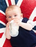 Kid with a bottle in hand Stock Photos