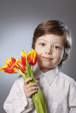 kid with a bouquet of tulips Royalty Free Stock Photo