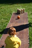 Kid Bowling. Red haired child bowling outdoor Stock Image