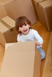 Kid with boxes Royalty Free Stock Images