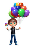 Kid boy with balloon & lollypop Royalty Free Stock Photos