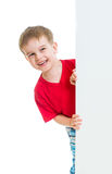 Kid boy behind blank advertising banner Royalty Free Stock Images