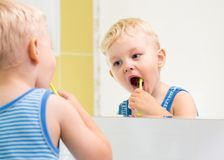 Kid boy brushing teeth Royalty Free Stock Images