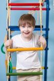 Kid boy climbing a rope ladder Stock Photos