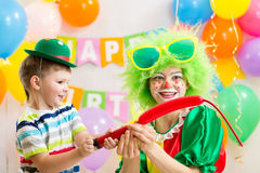 Kid boy and clown on birthday party Stock Photography